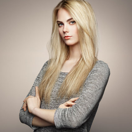 Blonde Haired woman with permanent Make up