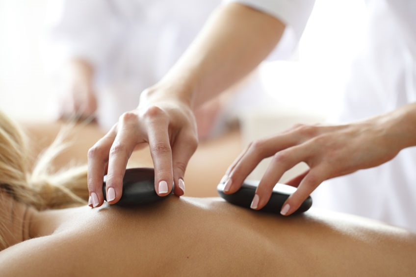 A therapist giving a Hot Stone Massage